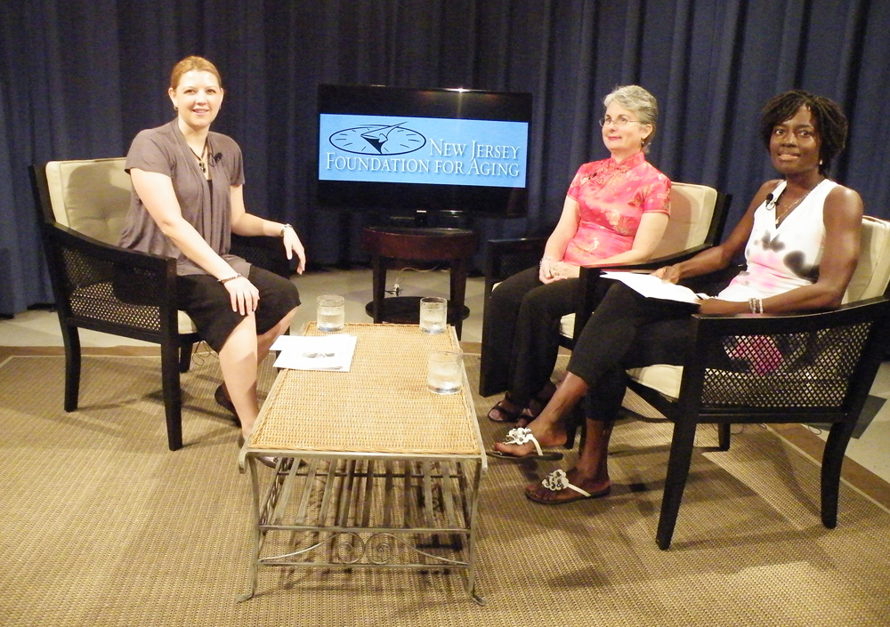 On the set from left to right: Melissa Chalker, Siobhan Hutchinson, and Romy Toussaint